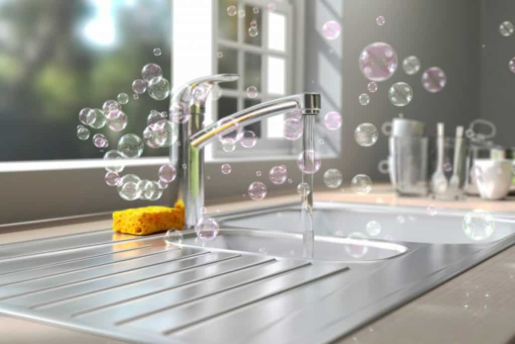 Soap bubbles floating around kitchen sink while washing dish